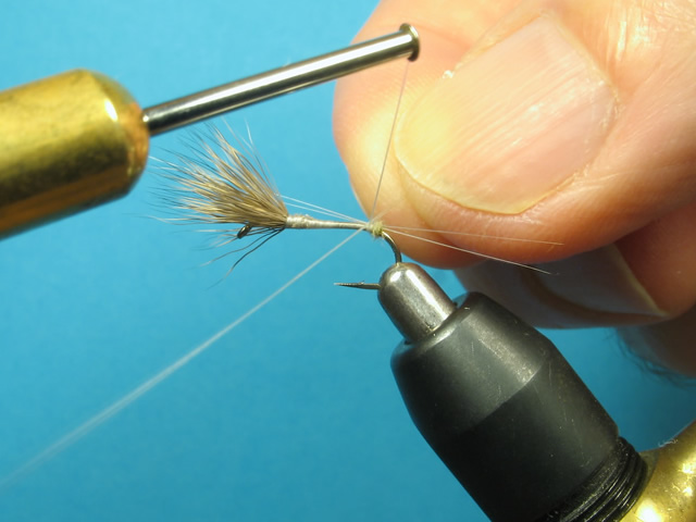 Tie in a couple more microfibbets of equal length on the opposite side to form the split tail